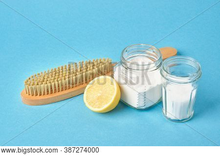 Wooden Brush. Jars With Soda And Citric Acid And Lemon On Blue Background Copy Space, Eco Friendly C