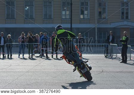 St Petersburg, Russia-september 26, 2020: Stunt Rider On His Bike Performs Some Tricks During Stunt