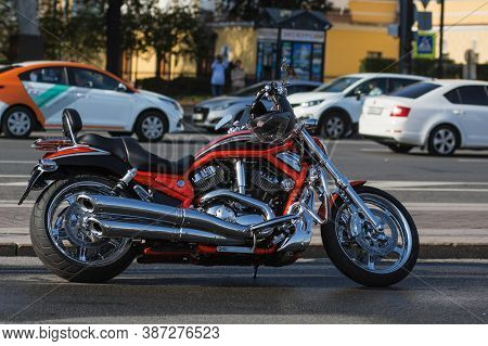St Petersburg, Russia-september 26, 2020: Red Harley-davidson V-rod Motorcycle On The City Streets D