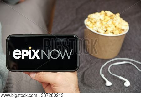 Epixnow Logo On The Smartphone Screen With Popcorn Box And Apple Earpods On The Background, Septembe