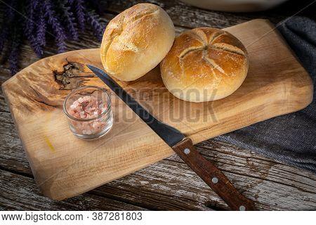 Homemade Kaiser Buns On Wooden Cutting Board.