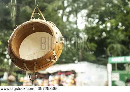 Wooden Tabla Back Side Hanging In Outside Of The Shop