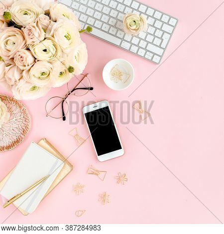 Stylized, Pink Womens Home Office Desk. Workspace With Computer, Bouquet Ranunculus And Roses, Phone
