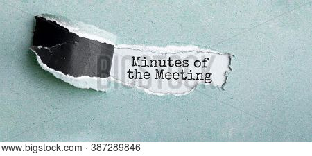 The Text Minutes Of The Meeting Appearing Behind Torn Brown Paper