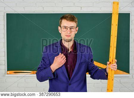 Man At Blackboard. Back To School. What Size Is It. Geometry Favorite Subject. Male Teacher Hold Mat