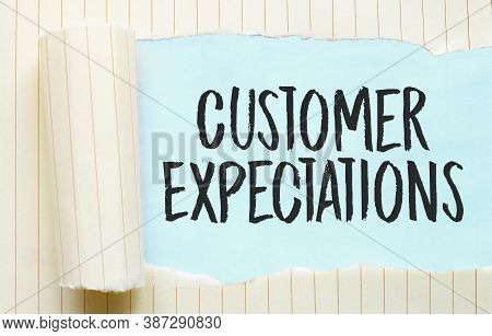 The Text Customer Expectations Appearing Behind Torn White Paper
