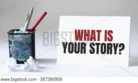 Blank Sheet, Pen And Crumpled Paper Balls On Grey Table, Flat Lay. Text What Is Your Story