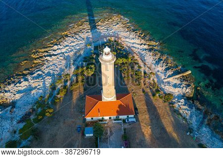 Aerial View Of Lighthouse Tower Of Veli Rat On The Island Of Dugi Otok, Croatia In Early Morning, Ad