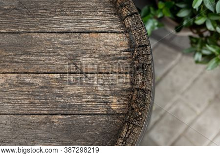 Close-up Background Of Top Of Old Retro Vintage Weathered Wooden Cask Barrel. Wineyard, Distillery,