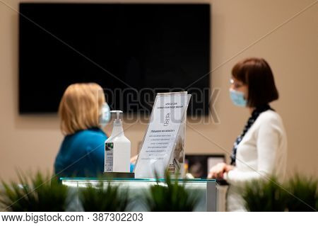 Vilnius, Lithuania - September 28 2020: Nurse, Receptionist Or Doctor And Patient At Clinic, Hospita