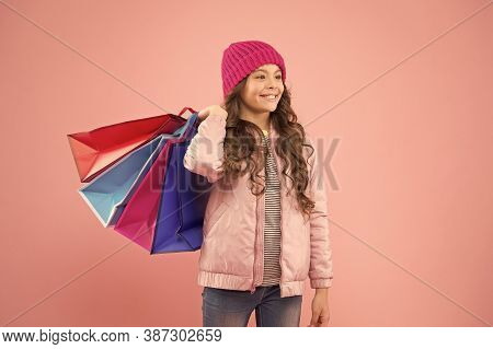 Great Sale Great Purchases. Happy Child Carry Purchases In Paperbags. Little Girl Smile With Fashion