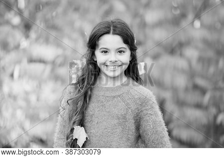 Autumn Brings Happiness And Joy. Happy Little Girl Wear Autumn Leaves In Hair. Small Child Happy Smi