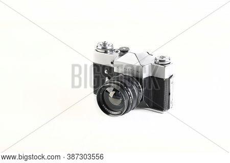 The Old Soviet 35 Mm Slr Camera Zenit-b, Released 1972 On White Background.