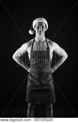 Plan And Cook Perfect Christmas Dinner. Athletic Santa In Cook Apron On Muscular Body. Fitness Cook.