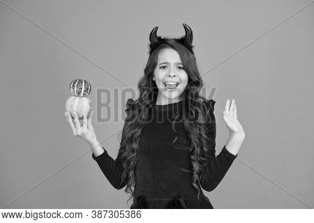 Oh No. Unhappy Child Hold Pumpkins Orange Background. Little Child With Unhappy Look Make Magic Tric