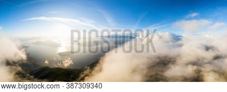 Beautiful Aerial Panoramic View Of Canadian Mountain Landscape During A Colorful Sunny Sunset. Taken