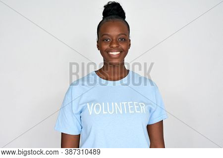 Happy Young African American Woman Activist Wear Volunteer Tshirt Look At Camera Isolated On Grey Ba