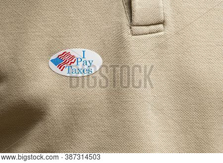I Pay Taxes Sticker On Mans T-shirt For Anger About The Lack Of Federal Tax Paid By President In The