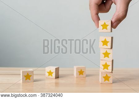 Hand Building Wood Block Cube Stacking On Top With Five Star Shape. The Best Excellent Business Serv