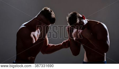 Two Professional Boxer Boxing. Two Young Boxers Facing Each Other In A Match. Two Men Boxers Boxing