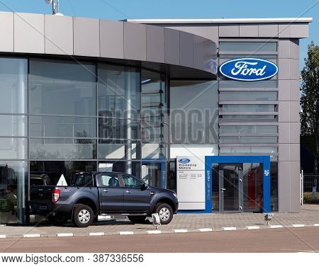 Buzau, Romania - October 21, 2015. Ford Dealership Building. The Ford Motor Company Is An American M
