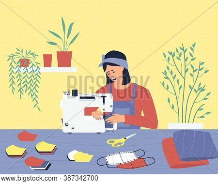 A Woman Works At Home, Sews Medical Masks From Fabric. A Seamstress At Home Works On A Sewing Machin