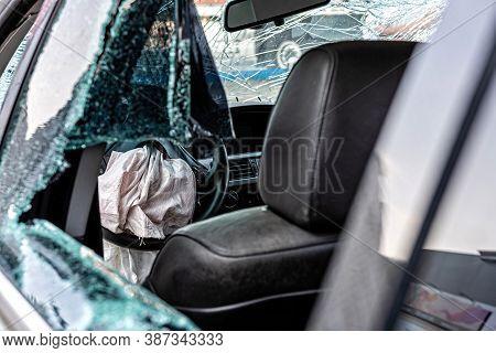 Damaged Vehicle Closeup After A Heavy Crash, Car Wreck, Exploded Airbag, Broken Windows