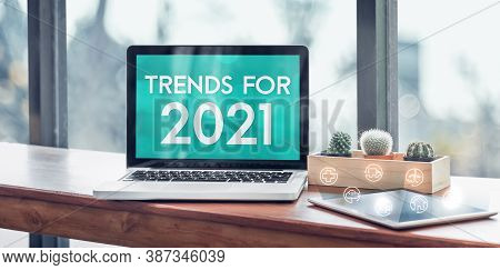 Trends For 2021 In Laptop Computer Screen With Icon Floating On Tablet On Wood Stood Table In At Win
