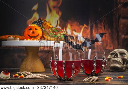 Halloween Kids Party Table With Candy Corns, Ginger Cookies, Spooky Donuts And Cranberry Drinks. Hap