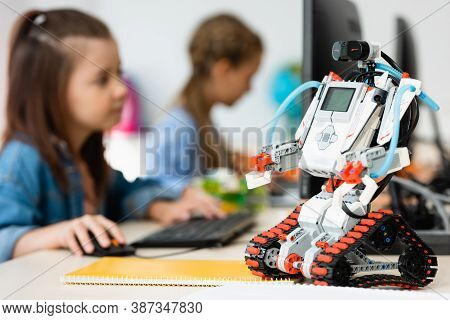 Selective Focus Of Robot Near Pupils Using Computer In Stem School, Background