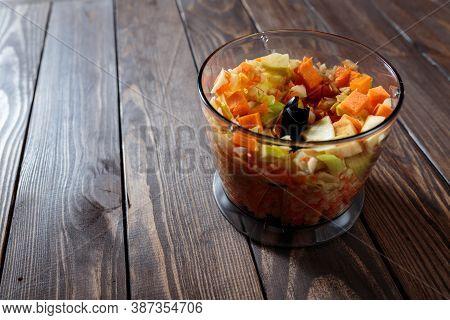 Making Carrot Applesauce In A Blender For A Baby. Chopped Apples And Carrots In A Blender Bowl.