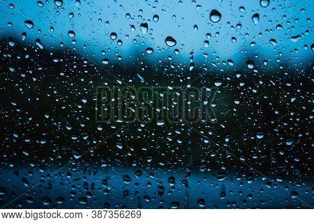 Close Up Raindrop On Glass Car In The Rainy Season.