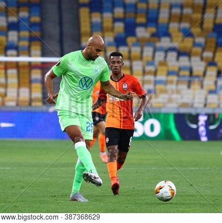 Kyiv, Ukraine - August 5, 2020: John Brooks Of Vfl Wolfsburg (l) Fights For A Ball With Marcos Anton