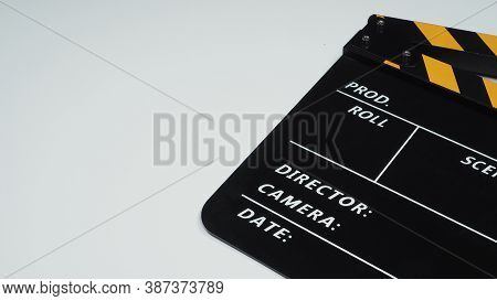 Black Clapperboard Or Movie Slate On White Background.it Use In Video Production And Film Industry .