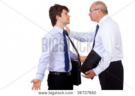 Angry senior businessman has an argue with young attractive businessman, isolated on a white background