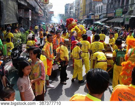 Bangkok, Thailand, November 14, 2015: People Following Two Dancing Lions In A Festival Of The Clans