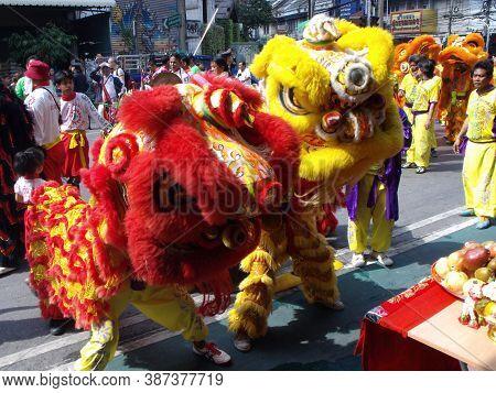 Bangkok, Thailand, November 14, 2015: Two Dancing Lions At A Chinese Community Clan Festival In Bang