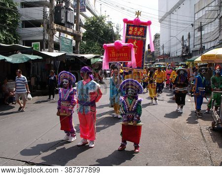 Bangkok, Thailand, November 14, 2015: A Group Of People With Colorful Dresses And Banners In A Festi