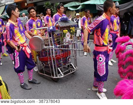 Bangkok, Thailand, November 14, 2015: Large Group Of Boys Carry A Cart With Drums In The Parade Of A