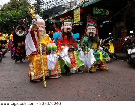 Bangkok, Thailand, November 14, 2015: Group Of Disguised People In The Parade Of A Festival Of The C