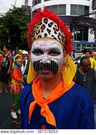 Bangkok, Thailand, November 14, 2015: A Man With His Face Painted In A Festival Of The Clans Of The