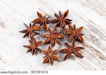 Some Star Anise Fruits On A Wooden Board, Close Up