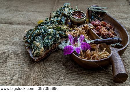 Crispy Flowers, Crispy Herbs And Crispy Vegetables Served  With Sweet Sauce In A Wooden Tray, Obliqu
