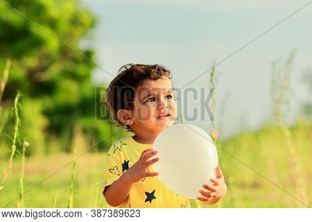 Indian Kid Portrait With Holding Birthday Balloon.portrait Of Cute Smiling Little Kid, Portrait Of A