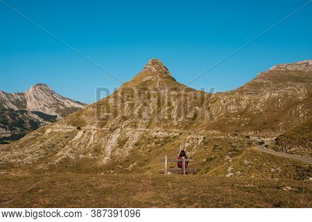 Woman Rest In Mountains National Park Durmitor Sitting On Bench.
