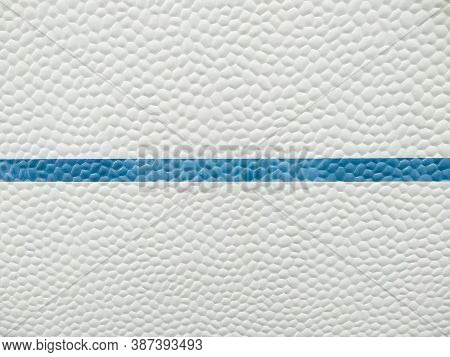 Closeup fiberglass applied to caravans. Abstract background texture: white with blue stripe surface structure of an old camper van. Strange seventies style plastic texture from vintage camping.