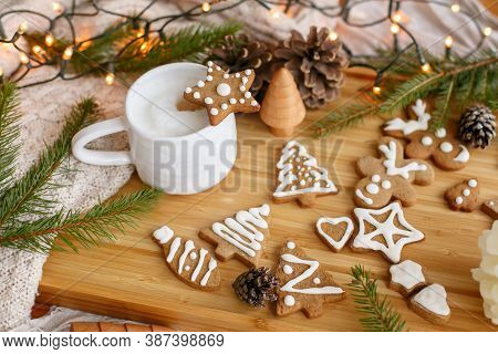 Christmas Star Gingerbread Cookie On Aromatic Coffee On Background Of Pine Cones, Fir Branches And W