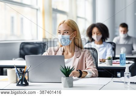 Modern Coworking Office Worker After Returning From Covid Quarantine To Office. Millennial Woman In