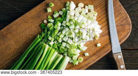 Fresh Green Onions On A Cutting Board