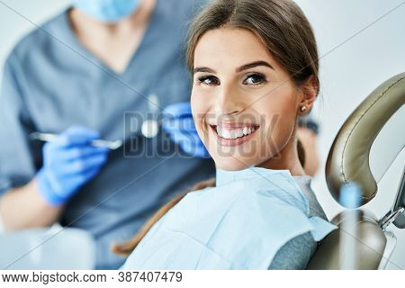 Male dentist and woman in dentist office